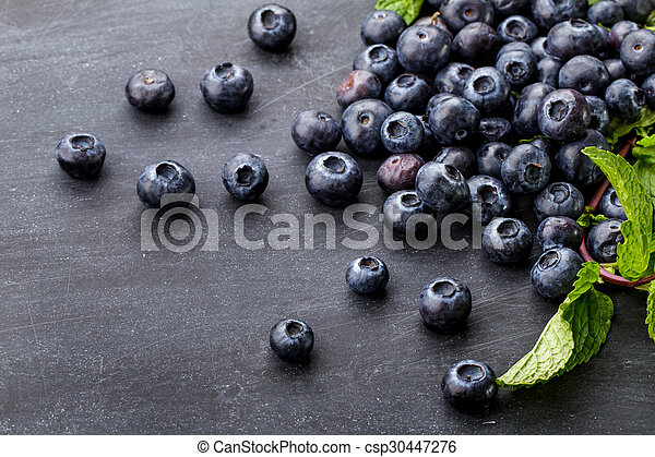 a pile of fresh blueberries - csp30447276