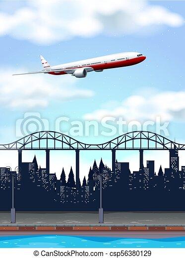 A Plane Above the City - csp56380129