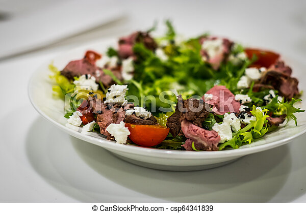 A plate of salad. Meats Vegetables Herbs - csp64341839