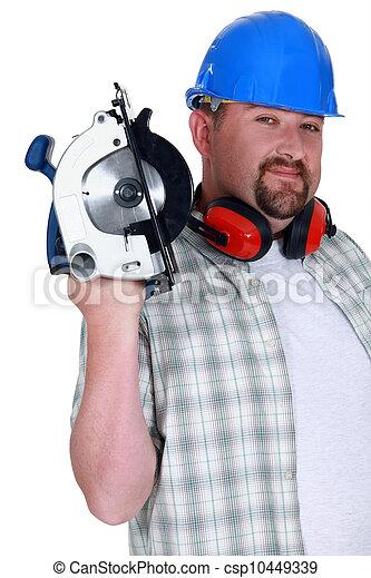 A plumb handyman with a circular saw. - csp10449339