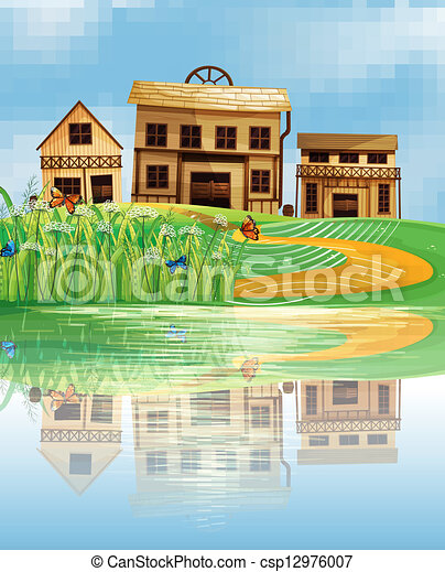 A pond with a reflection of the wooden houses - csp12976007