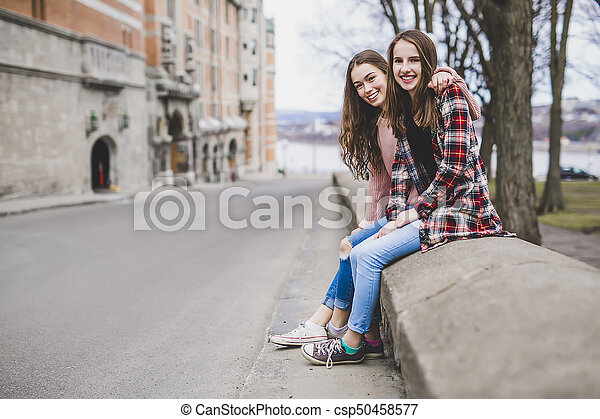 A Portrait of a teen girl with long hair in an urban - csp50458577