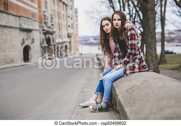 A Portrait of a teen girl with long hair in an urban - csp50458602