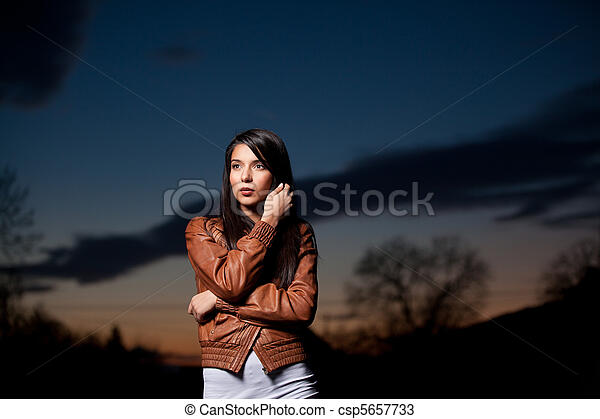 a portrait of a young woman at sunset - csp5657733