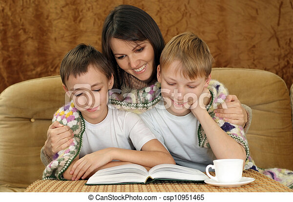 A pretty Caucasian mother with her son sitting on the couch - csp10951465