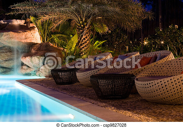 A pretty swimming pool in night at a local resort - csp9827028