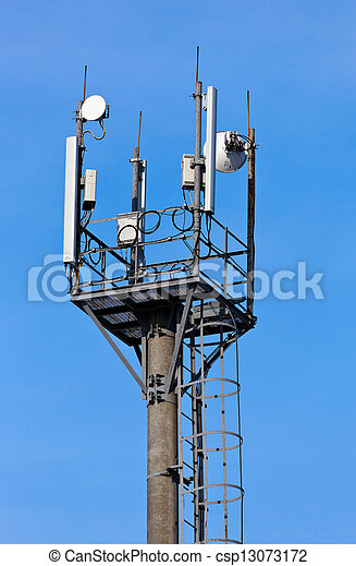 A radio communications tower against blue sky - csp13073172