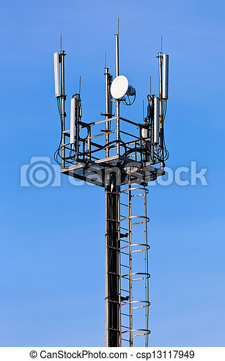 A radio communications tower against blue sky - csp13117949