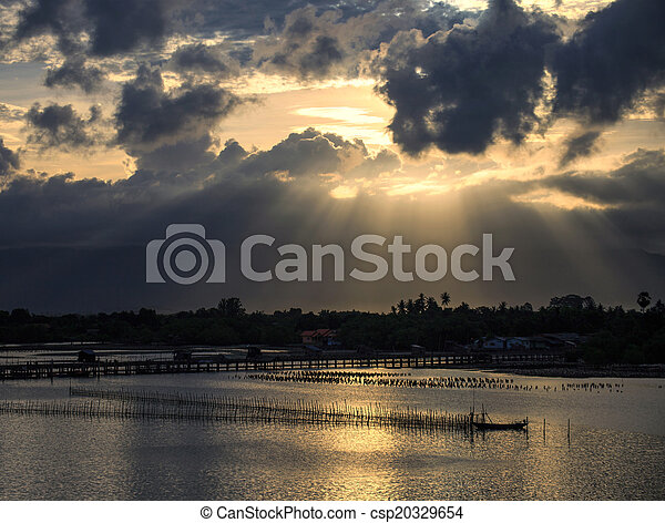 A ray of sunlight breaking through dark clouds - csp20329654