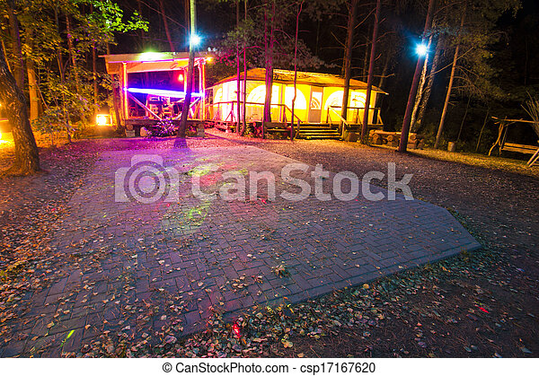 a recreation place in forest at night - csp17167620