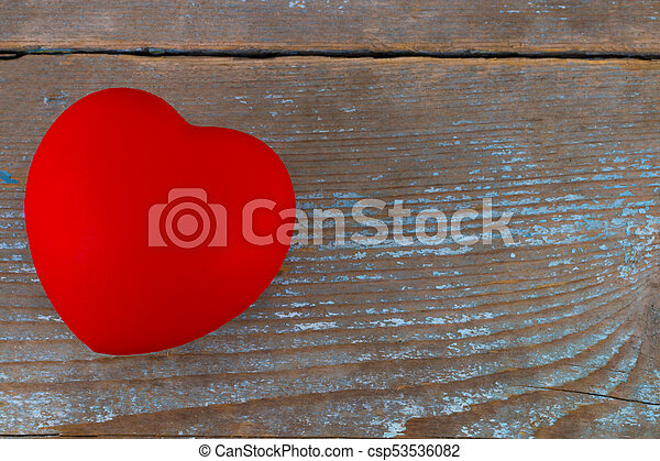 A red heart on the wooden background - csp53536082