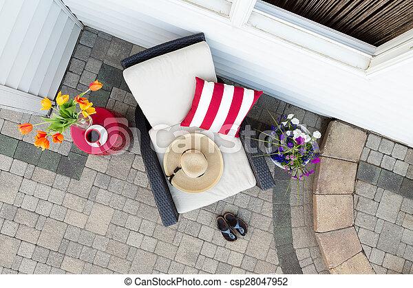 A relaxing tea break in a deep seating patio set - csp28047952