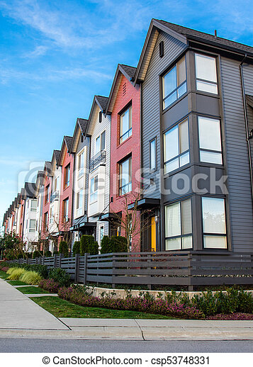 A row of new real estate townhouses or condominiums. - csp53748331