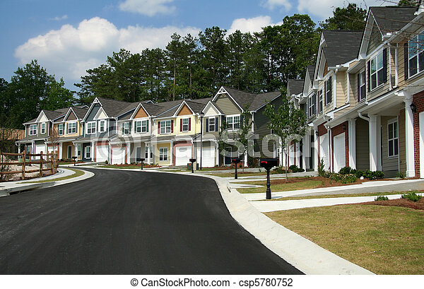 A row of new townhomes or condominiums - csp5780752