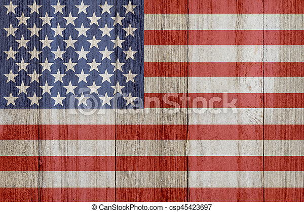 A rustic old USA flag on weathered wood - csp45423697