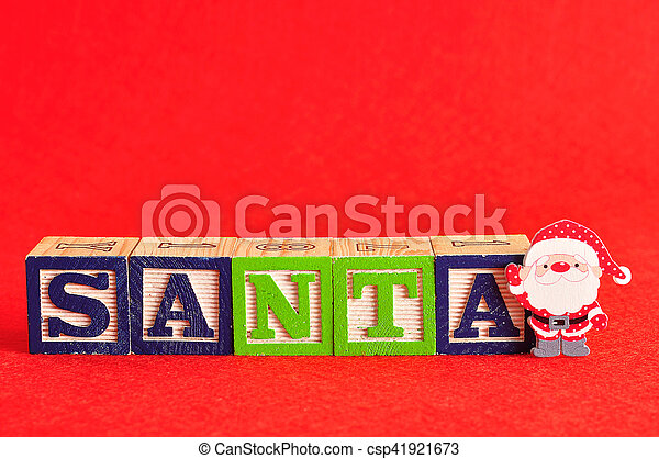 A santa with the word santa spelled with colorful alphabet blocks - csp41921673