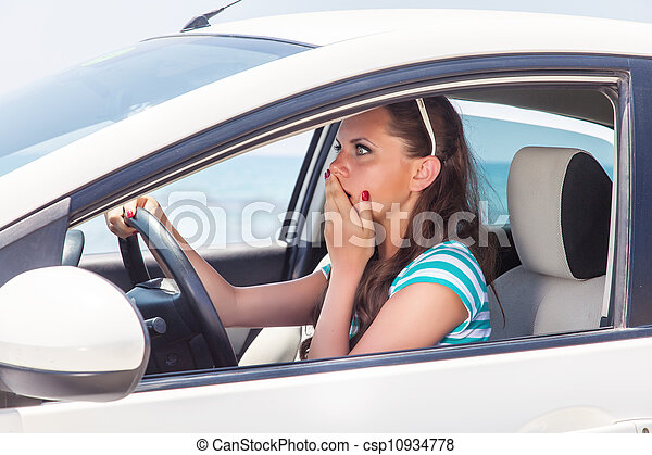 A scared woman is in the car - csp10934778