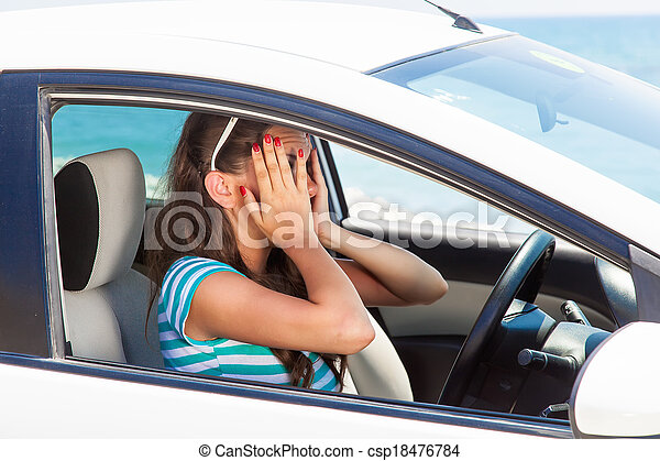 A scared woman is in the car - csp18476784