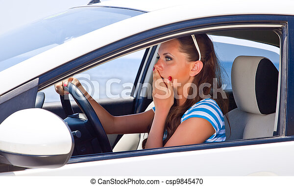 A scared woman is in the car - csp9845470