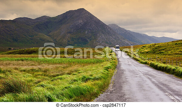 a scenic irish nature landscape with tourist bus - csp2847117