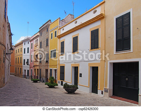 houses painted yellow and blue