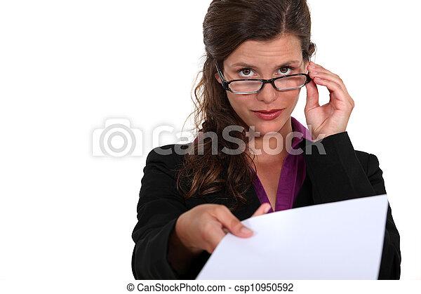A secretary handing a piece of paper. - csp10950592