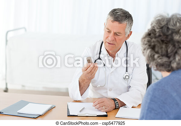A senior doctor talking with his pa - csp5477925