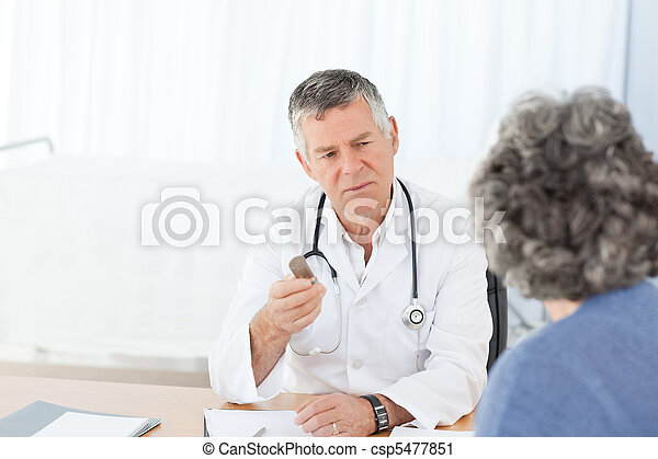 A senior doctor talking with his patient - csp5477851