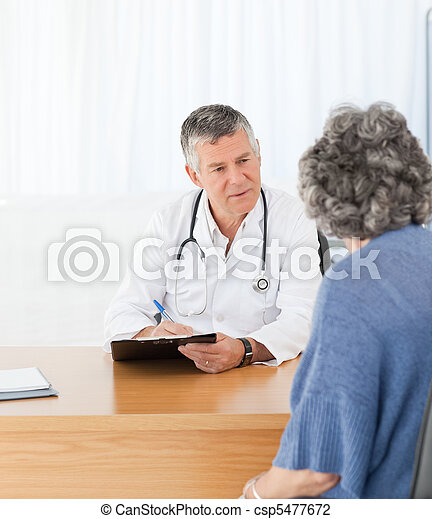A senior doctor talking with his patient - csp5477672