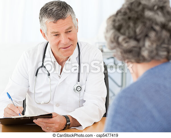 A senior doctor talking with his patient - csp5477419