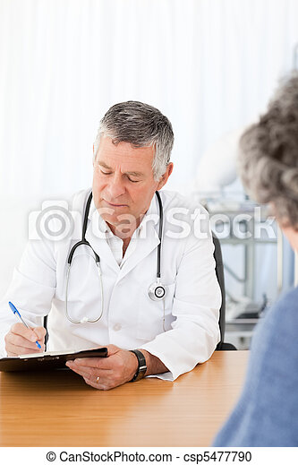 A senior doctor talking with his patient - csp5477790