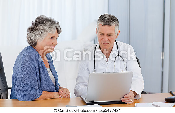A senior doctor with his patient  - csp5477421