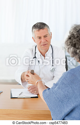 A senior doctor with his patient - csp5477483