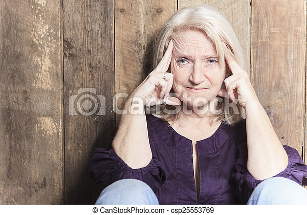 A senior woman pray with a wood background - csp25553769