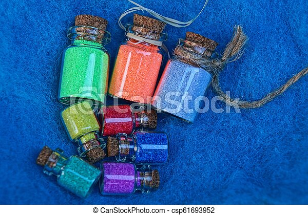 a set of small glass decorative bottles with colored sand - csp61693952