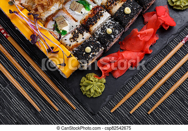 A set of sushi from many types of roles and with different stuffing. Sushi menu. - csp82542675