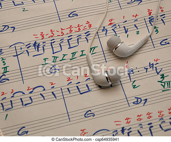 A sheet of music with earphones - csp64935941