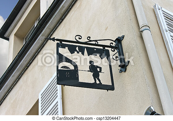 A sign on the front of the house in Chartres, France - csp13204447