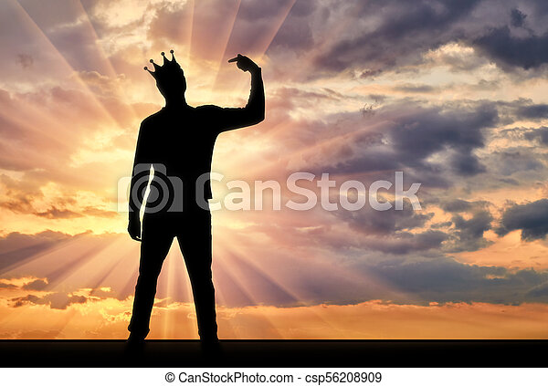 A silhouette of a narcissistic man with a crown on his head shows his finger on himself. He tries to attract attention - csp56208909