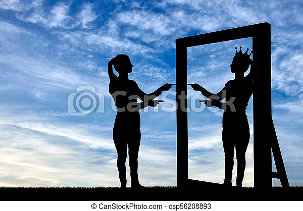 A silhouette of a narcissistic woman raises her self-esteem in front of a mirror - csp56208893