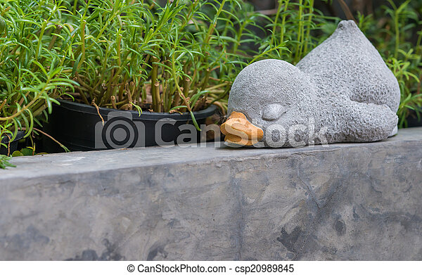 A sleeping duck made from cement for decoration - csp20989845