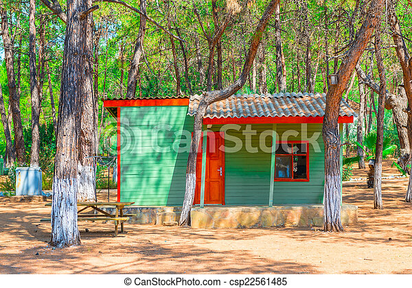 a small guest house in the coniferous forest - csp22561485