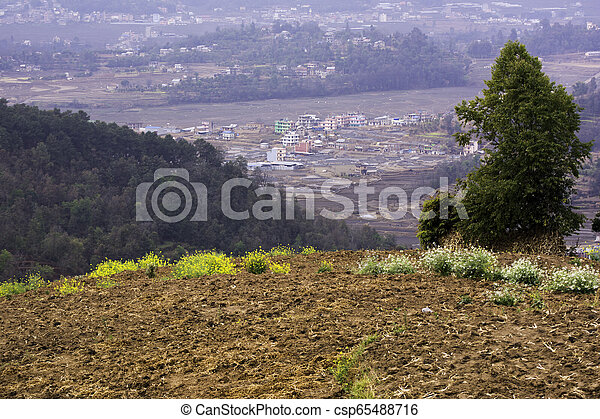 A small remote village of Nepal surrounded by hills - csp65488716
