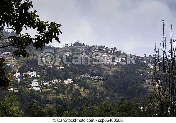 A small remote village of Nepal surrounded by hills - csp65488588