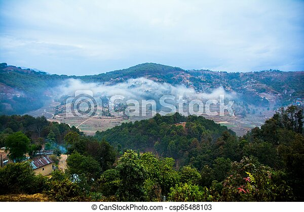 A small remote village of Nepal surrounded by hills - csp65488103