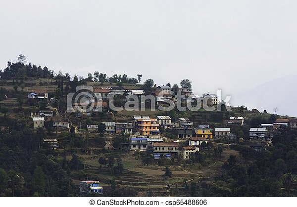 A small remote village of Nepal surrounded by hills - csp65488606