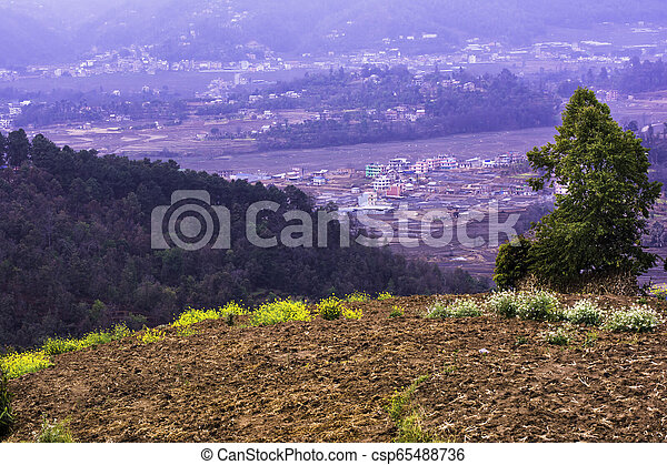 A small remote village of Nepal surrounded by hills - csp65488736