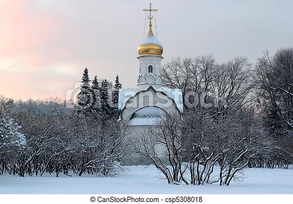 a small russian church at sunset - csp5308018