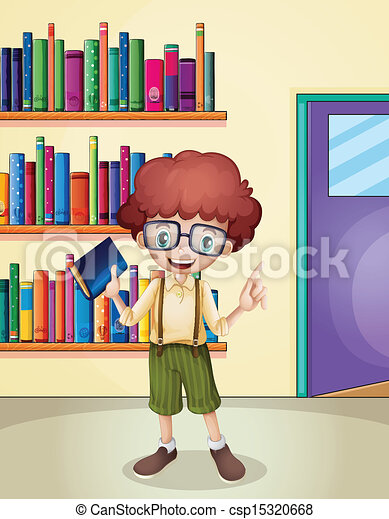 A smiling boy holding a book in front of the bookshelves - csp15320668