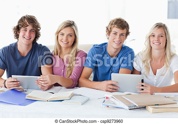 A smiling group of students looking at the camera - csp9273960